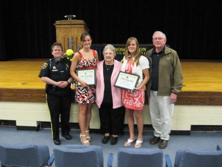Officer Erin Kelley, Recipient Amy Burmster, ACT-NOW Chairperson Mary Link, Recipient Danielle Clear and ACT-NOW GAP representative John Klein pose at Awards Night at Roscommon High School